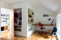 Childs bedroom study area, with recessed shelving and clothes hangers