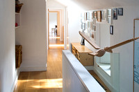Full length of mews corridor bathed in natural light